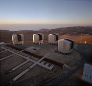 The four telescopes of the European Southern Observatory Paranal site. The VLTI (Very Large Telescope Interferometer) building is the low structure in front of the telescopes. Image courtesy of the .